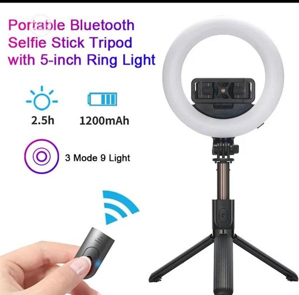 رینگ لایت چراغ مطالعه ،مونو پاد و سه پایه نگهدارنده موبایل مناسب فیلمبرداری ، عکاسی و ساخت استوری و لایو اینستاگرام تری پاد و رینگ لایت بدونه سیم با شاتر مناسب اندروید و ایفون برند اصلی سلفی استیک مدل L07 اصلی همراه با شاتر حرفه ای L07 Bluetooth Selfie Stick Tripod with 5 inch LED Ring Light